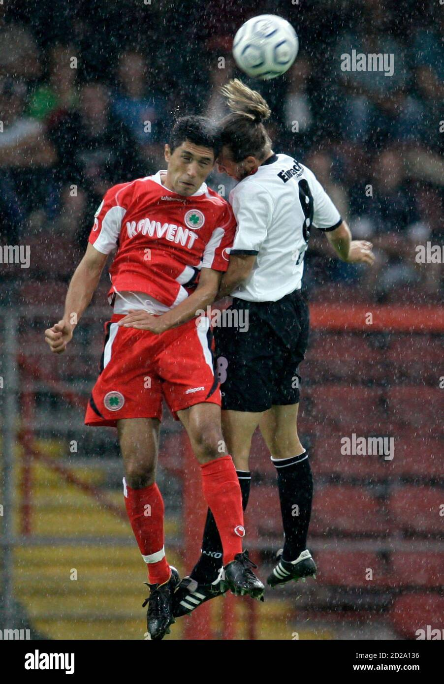 Rot Weiss Oberhausen S Ali Sirin And Eintracht Frankfurt S Lexa Jump For Ball During German Soccer Cup First Round Match In Oberhausen Germany Rot Weiss Oberhausen S Mehmet Ali Sirin L And Eintracht Frankfurt S Stefan Lexa