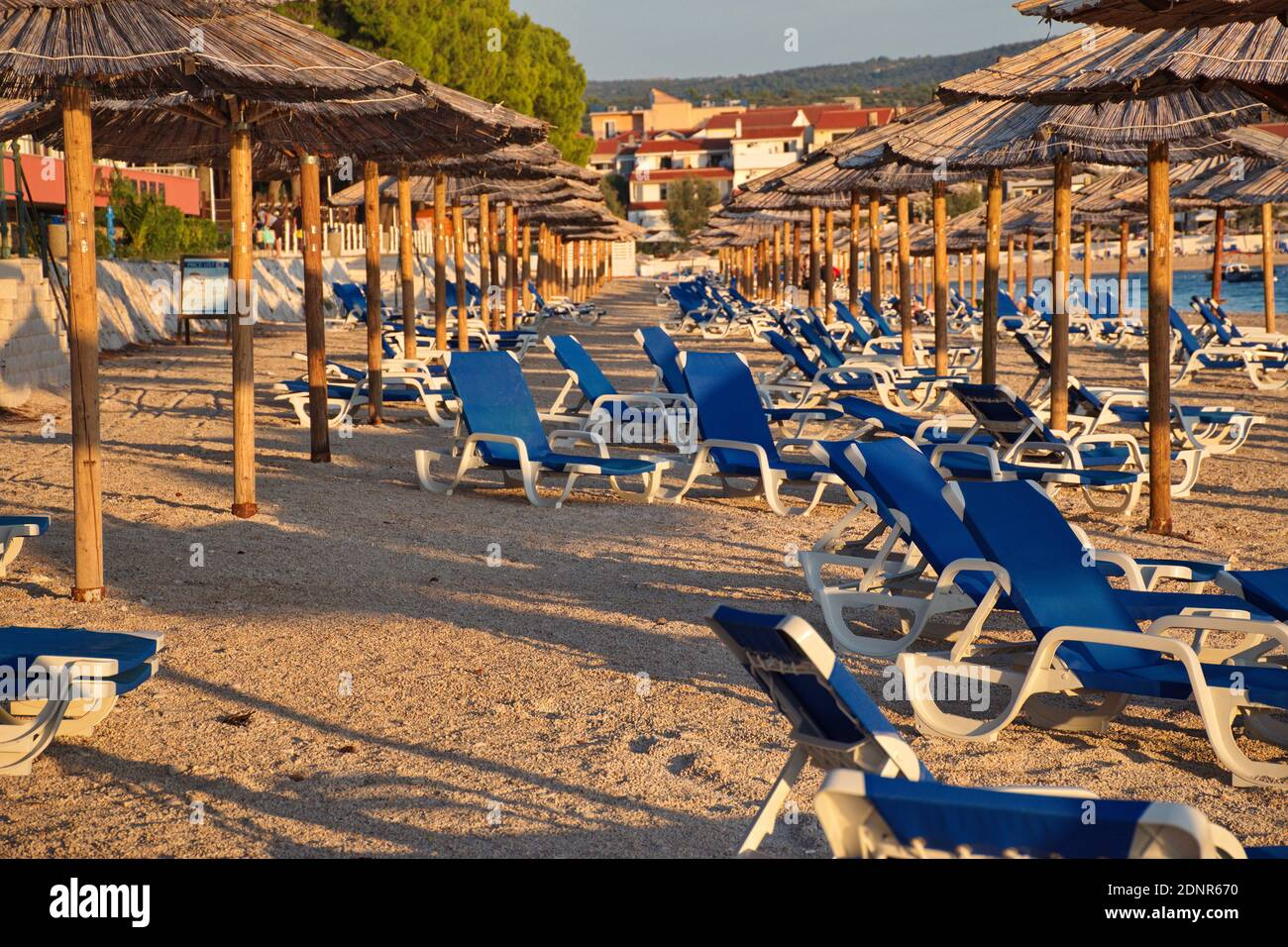 Group Of Parasols And Beach Chairs On The Beach In Primosten In Sunset Stock Photo Alamy