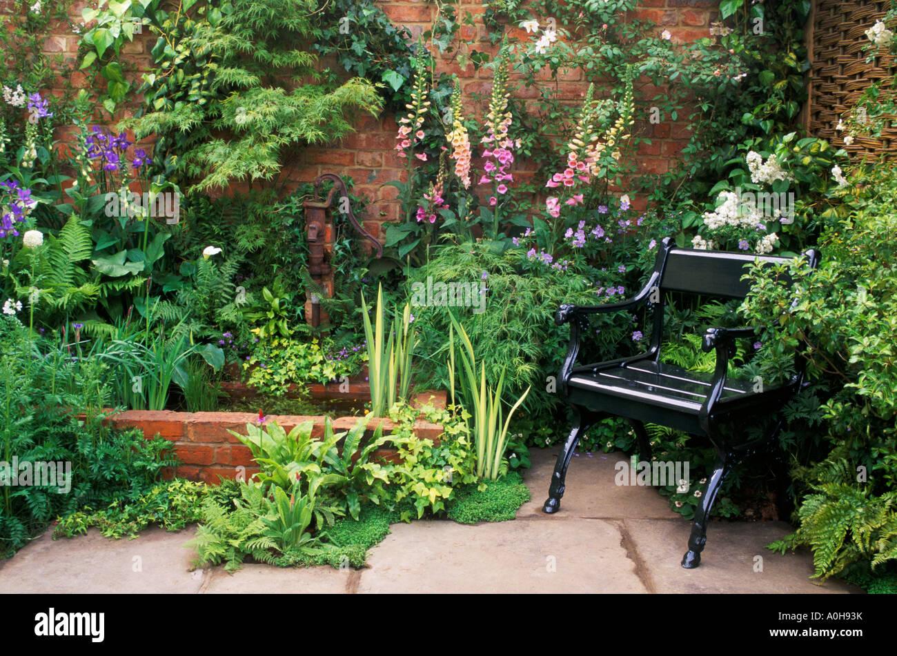 Raised Brick Pond In Small Walled Garden Design Roger