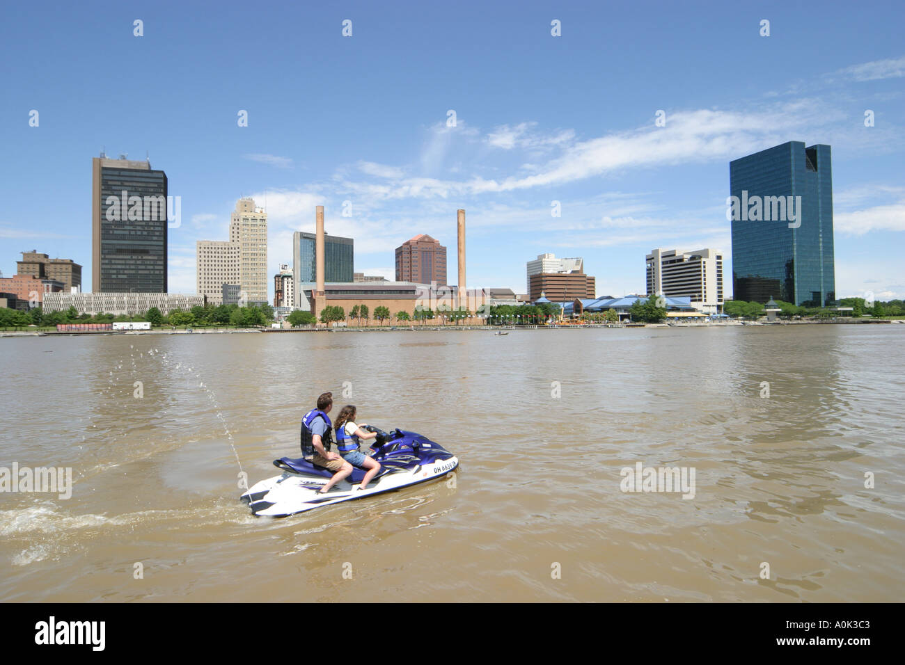 Toledo ohio maumee river jet ski downtown skyline view from the docks father daughter girl