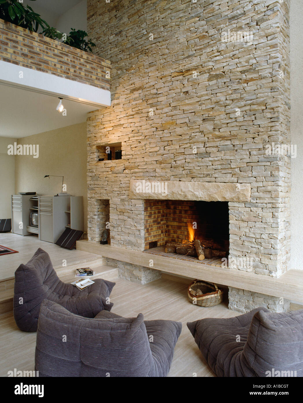 Fire Stones For Fireplace Lit Fire In Fireplace In Stone Wall Of Barn Conversion With