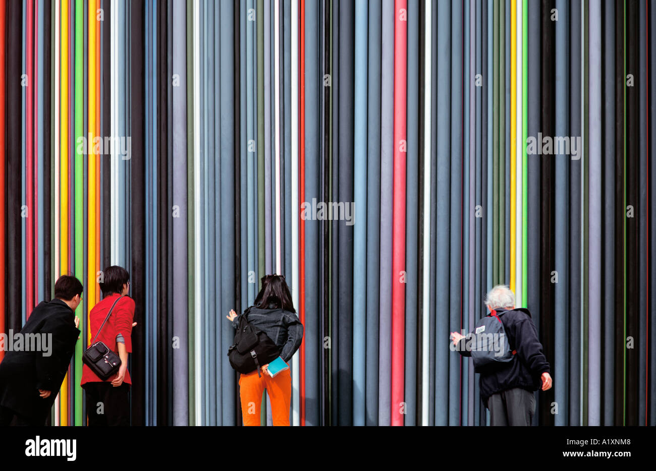 People Touching The Cheminee D Aeration At La Defense Paris Stock Photo Alamy