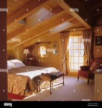 A bedroom with skylight window in a traditional chalet in ...