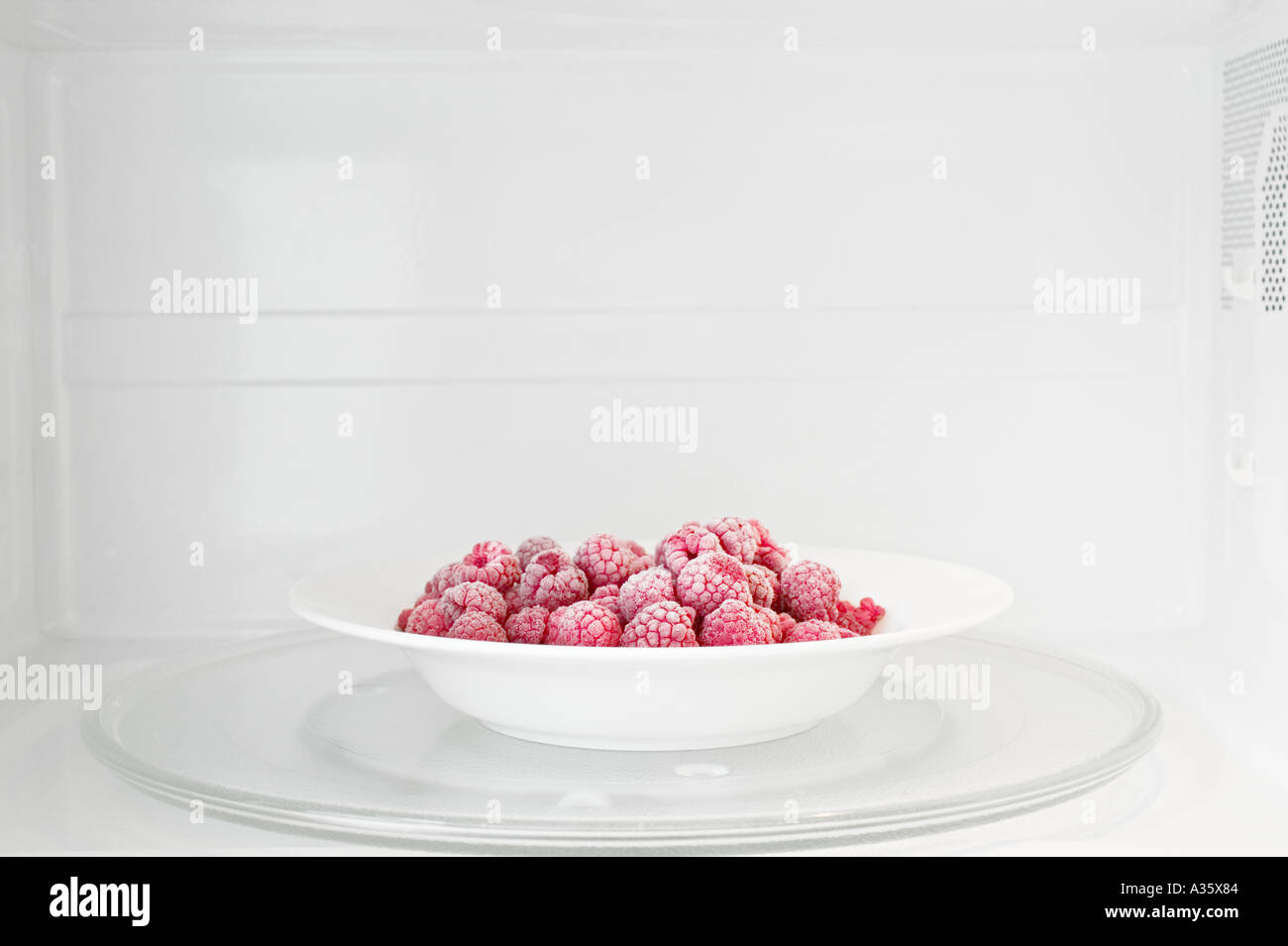 Microwave Plate Plate Of Frozen Raspberries In Microwave Oven Stock Photo 3487363