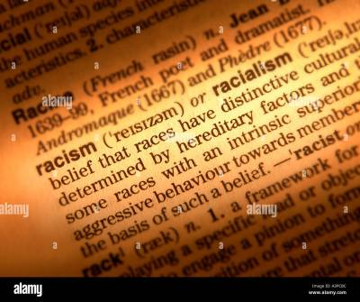 CLOSE UP OF DICTIONARY PAGE SHOWING DEFINITION OF THE WORD RACISM Stock Photo, Royalty Free ...