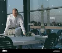 Sir Norman Foster in his office. Portraits of architects ...