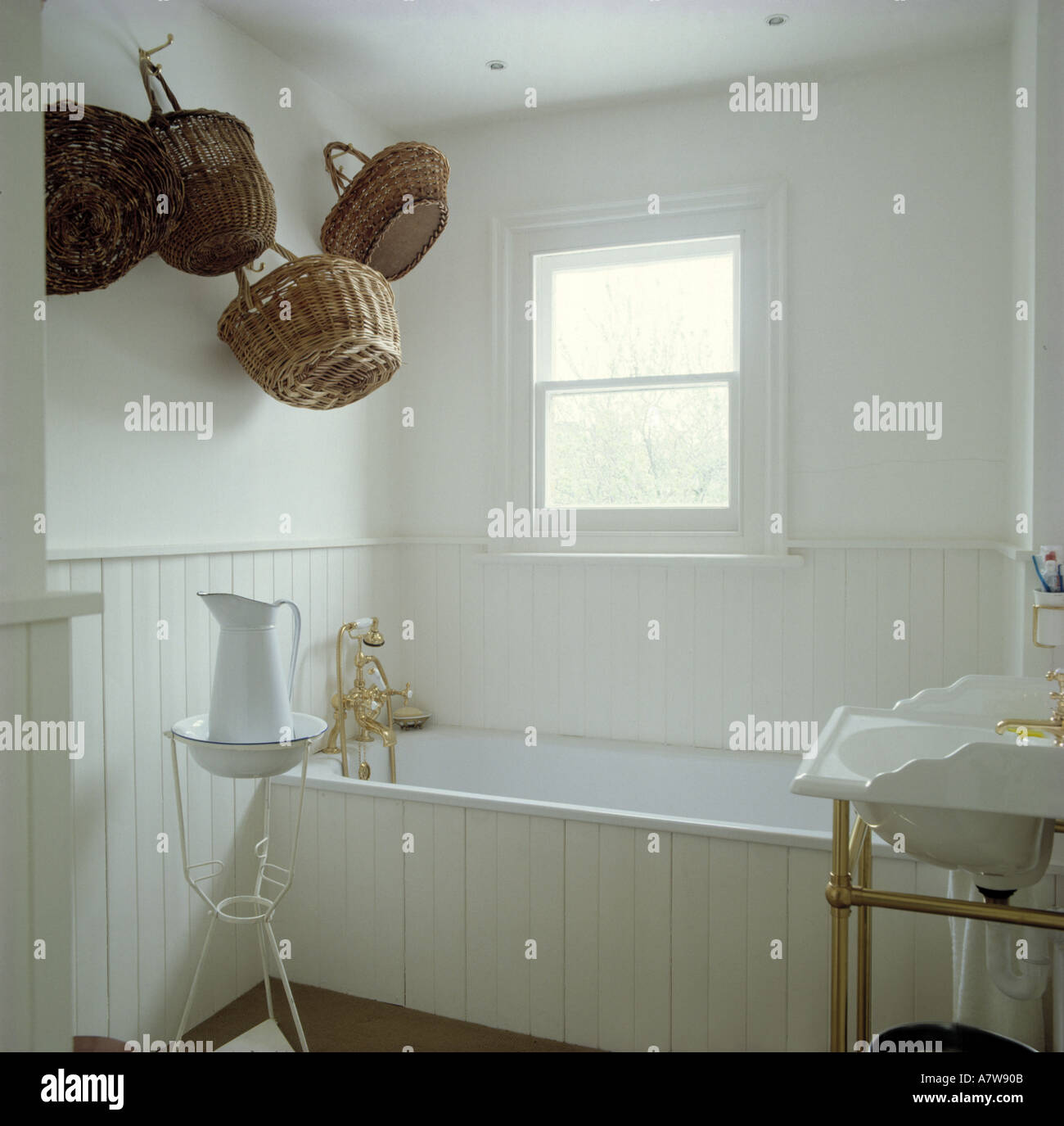 Collection Of Baskets On Wall In White Tongue Groove Panelling In Stock Photo Alamy