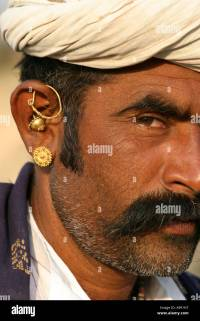 Gujarati Tribal man wearing typical mix of gold earrings ...