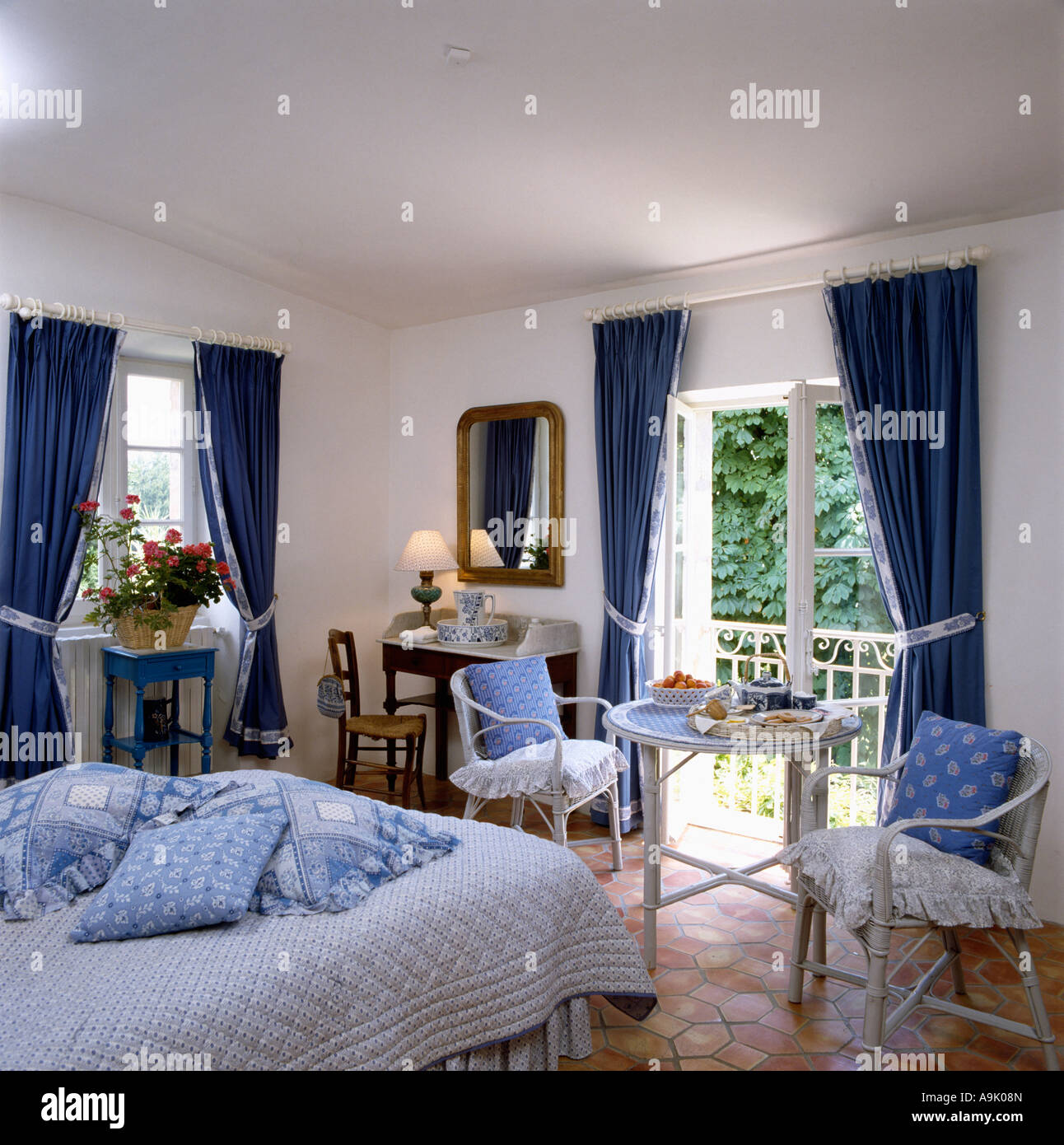 Curtains For A Blue Room Blue Cushions Piled On Bed In Country Bedroom With Blue Curtains