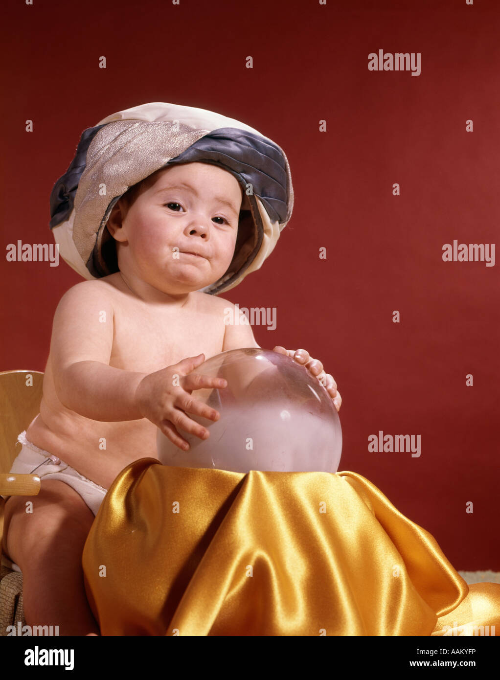 Baby Teller Baby With Fortune Teller Turban Headdress Holding Hands On