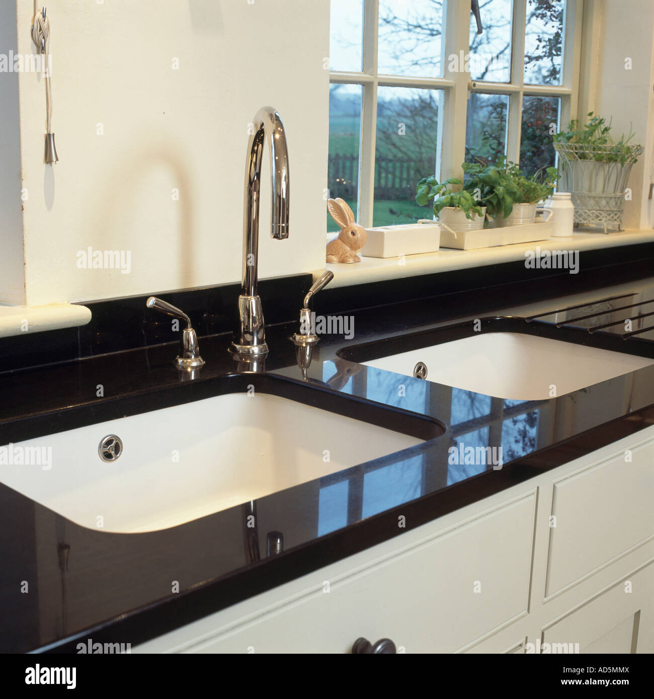 Double White Sinks And Chrome Taps In Black Granite