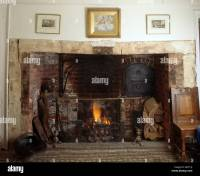 Fireguard in front of inglenook fireplace in traditional ...