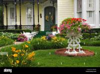 Flower Garden in Front Yard of Home on Mansion Row New ...