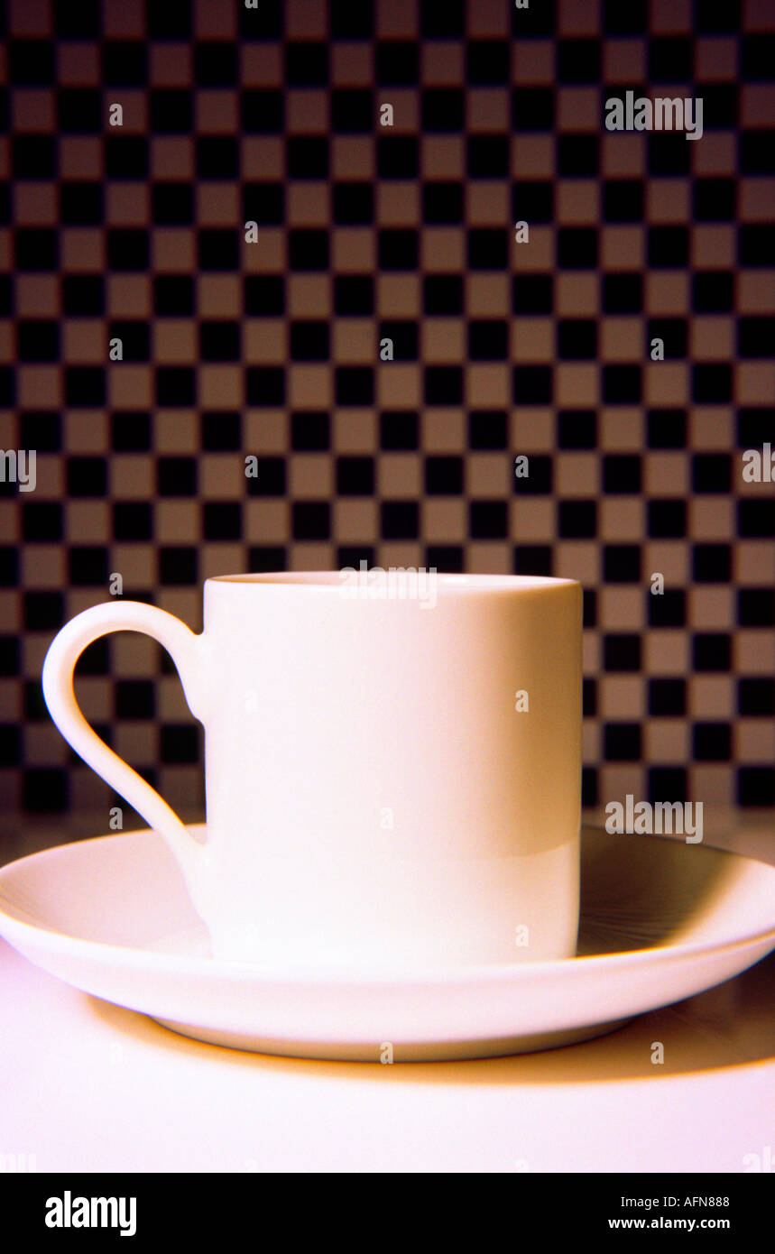 Small Coffee Cups And Saucers One White Small Coffee Cup On A Saucer With Chequered Background