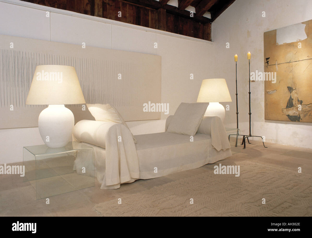 Side Lamps For Living Room Lighted White Lamps On Either Side Of Sofa With Loose Cover In All