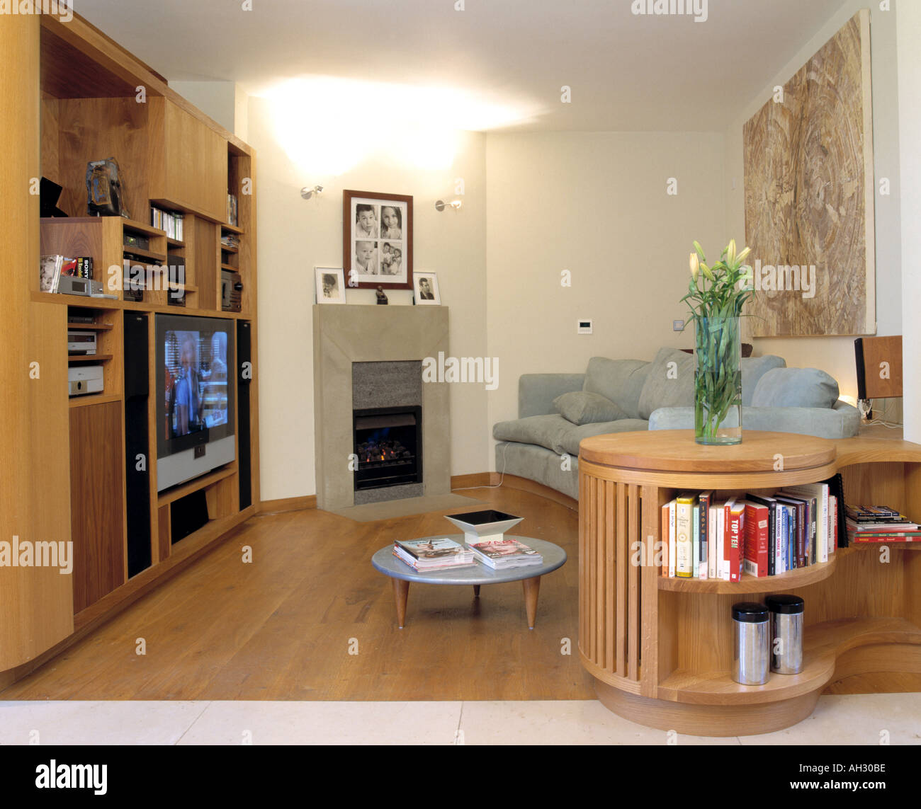 Large Wall Units For Living Room Books On Circular Shelf Unit In Modern Living Room With Wooden