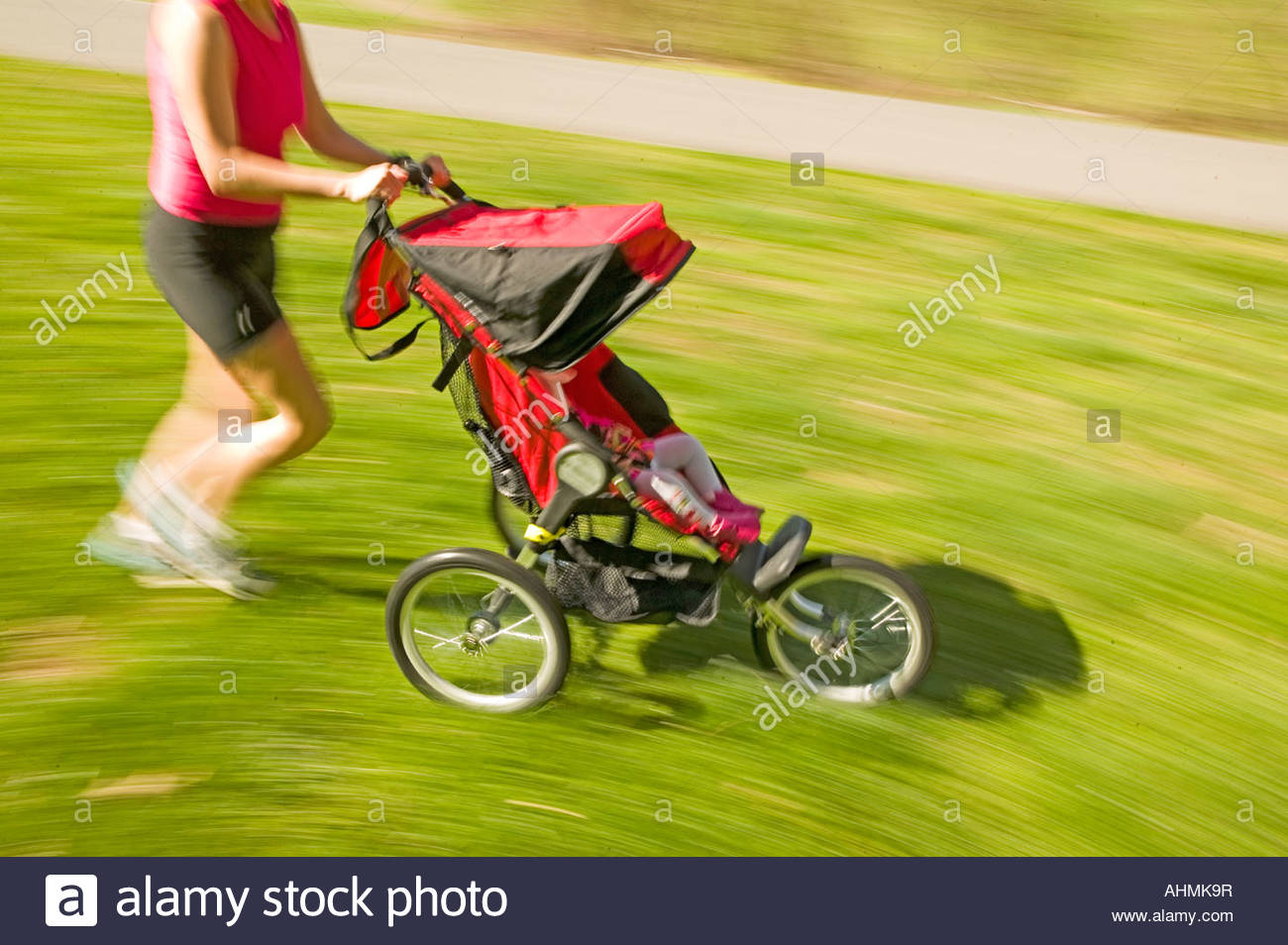 Toddler Stroller Jogging Woman Jogging With Baby In A Jogging Stroller Stock Photo