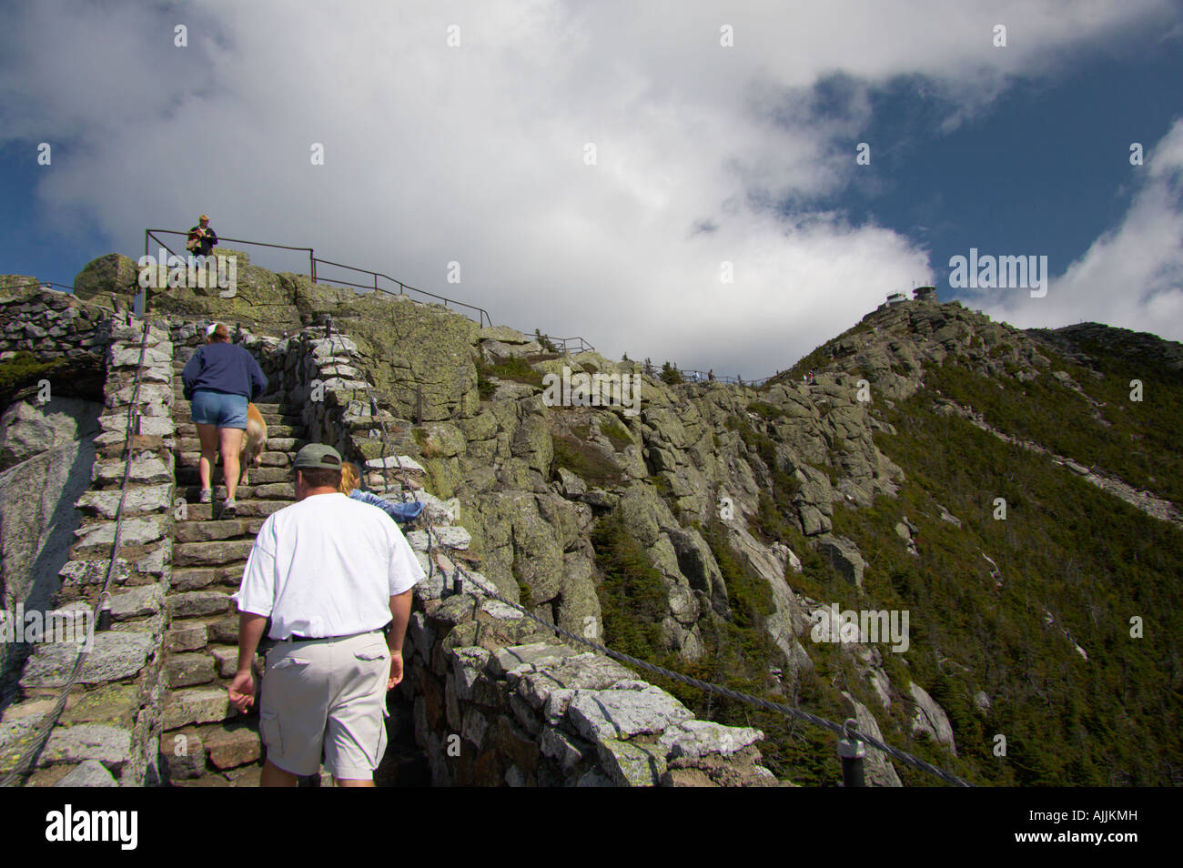 People Walking Up Stairs Leading To Summit Of Whiteface