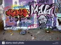 Gang Graffiti on Wall and Spray Paint Cans along the San ...
