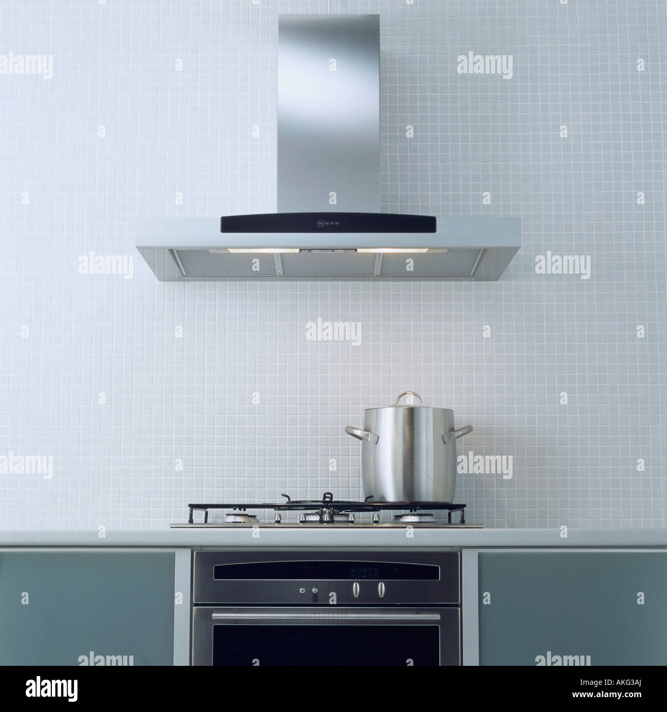 Modern Kitchen Fans Stainless Steel Extractor Fan Above Pan On Hob In Modern