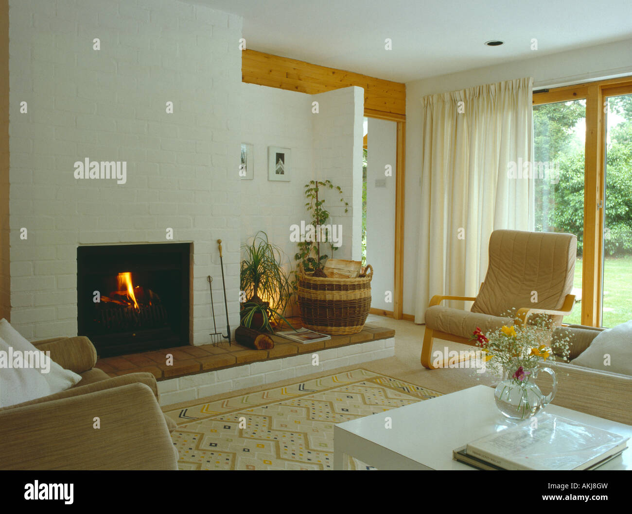 Lighted Fire And White Curtains In Modern Living Room With Stock Photo Alamy - Vorhang Skandinavisches Design