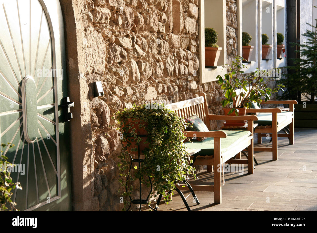 Plant Bench Indoor Potted Plants And Benches In Front Of House Stock Photo