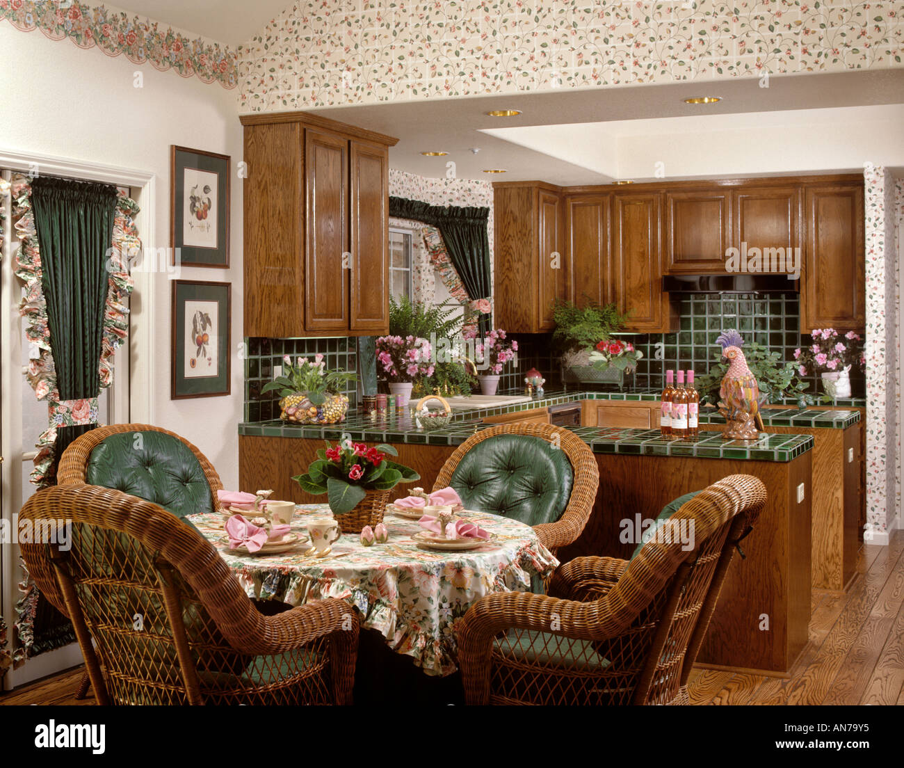 kitchen dining room with wicker chairs green tile and window treatments AN79Y5