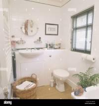 White built in basin in vanity unit in small white ...