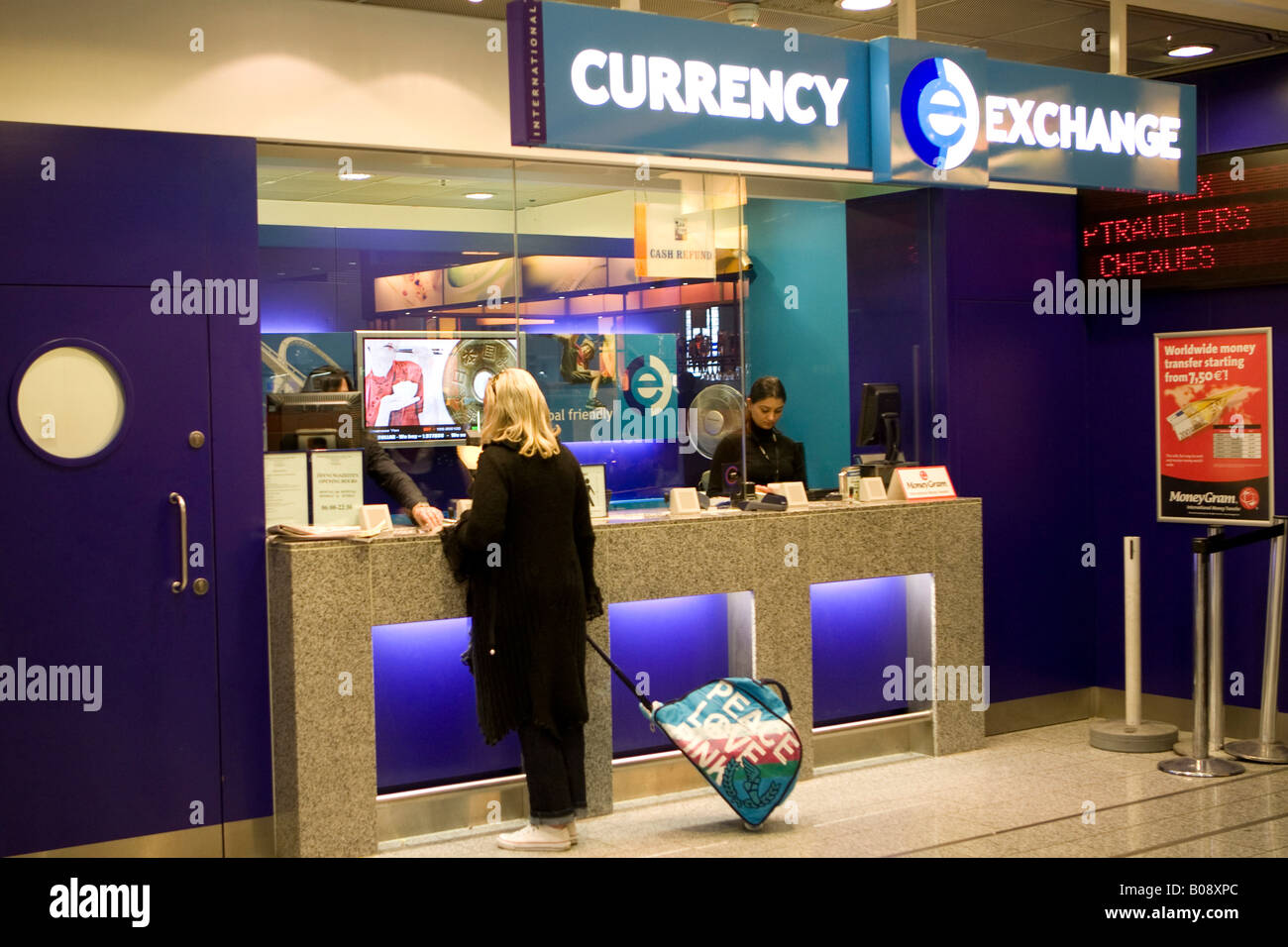 Young Woman Changing Money At A Currency Exchange Counter Frankfurt Stock Photo Alamy