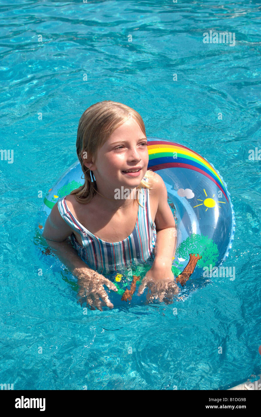 Float Berlin Girl With Swim Ring In A Swimming Pool Stock Photo