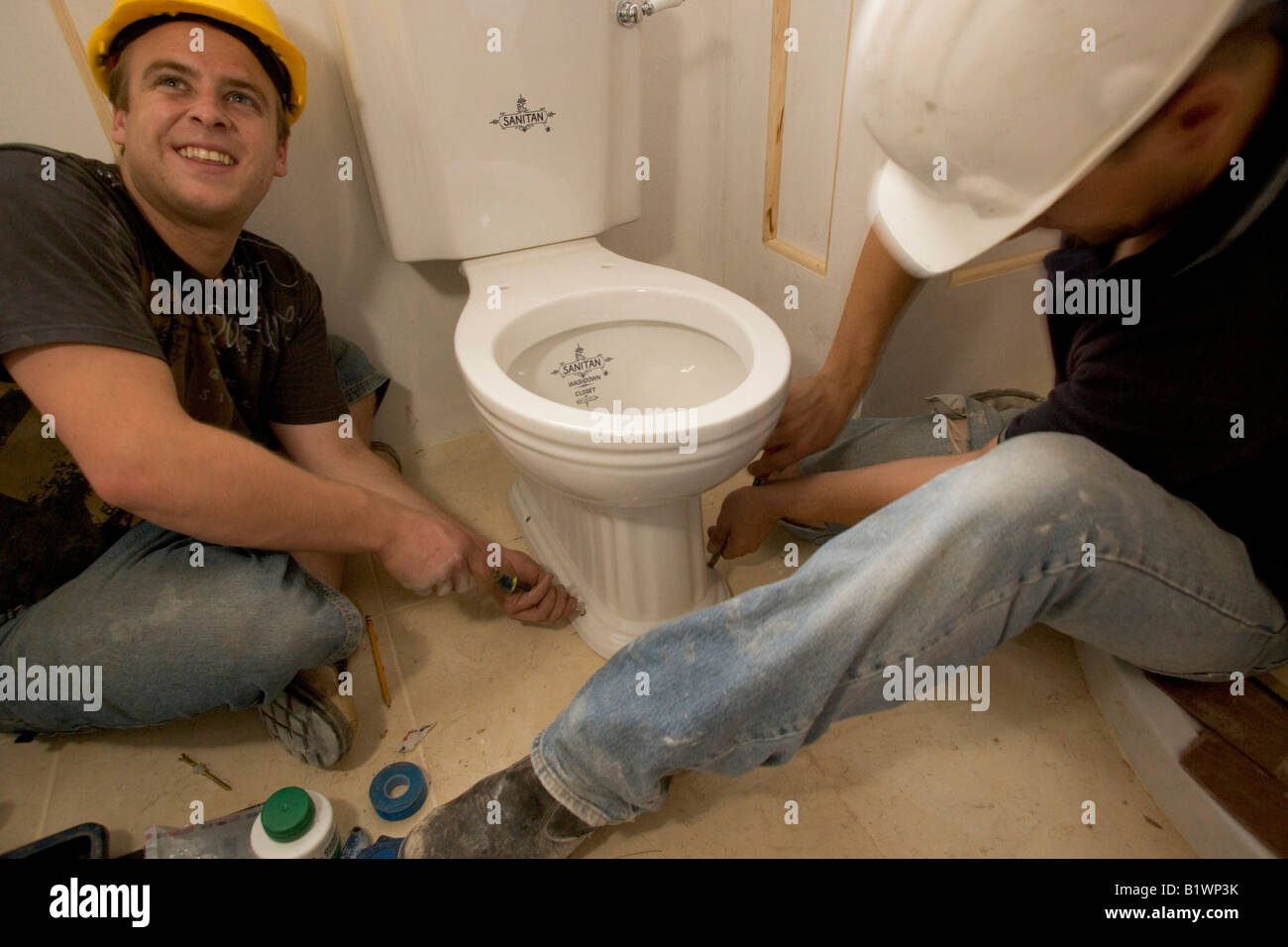 Install A Toilet Two Builders Install A Toilet Stock Photo 18391175 Alamy