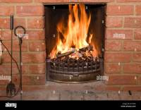 open fire burning in a brick fireplace Stock Photo ...