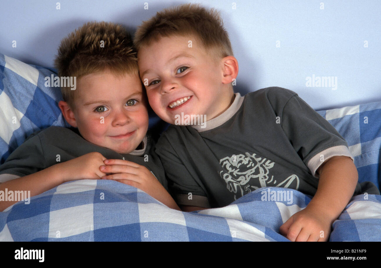 Little Boy Twin Bed Cheeky Little Twin Boys Laying In Bed Stock Photo Royalty