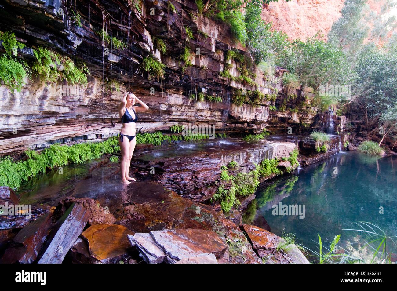 Girl Walking Alone Wallpaper Waterfall Shower At Circular Pool In Karijini National