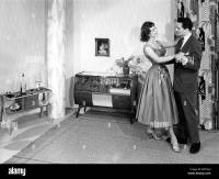 Couple dancing in the living room, historic picture from