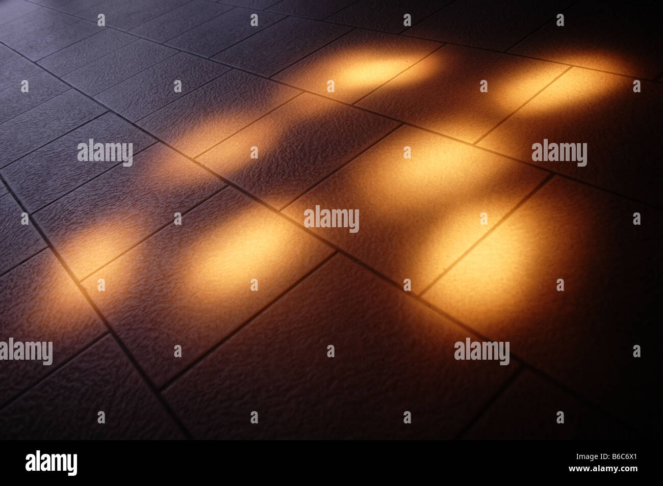 Small Floor Spotlights Grouping Of Small Yellow Spotlights On A Tiled Floor Stock Photo