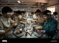 Workers in a diamond cutting workshop in Surat City ...