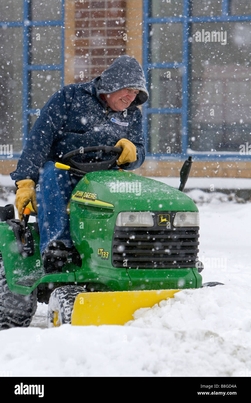 John Deere Snow Plow John Deere Riding Lawn Mower Fitted With A Snow Plow Removing Snow