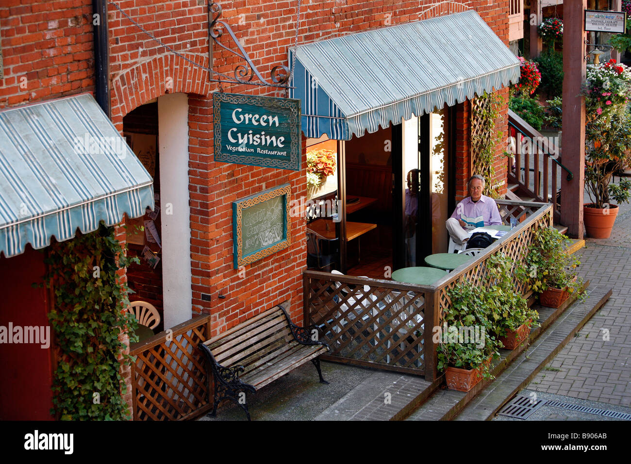 Green Cuisine Cafe A Man Sits On The Outdoor Patio At Green Cuisine