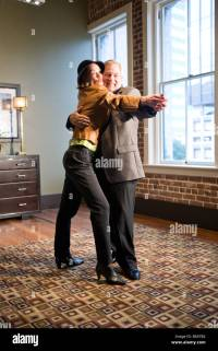 Romantic middle-aged couple dancing in living room Stock ...