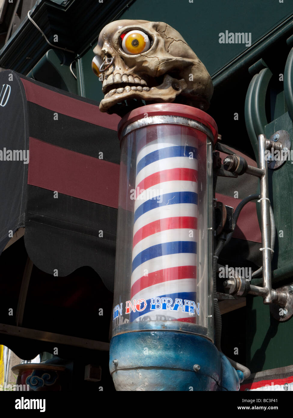 Tattoo Berlin Prenzlauer Berg Barbers Pole And Skull Outside The Tattoo Parlour No Pain No Brain