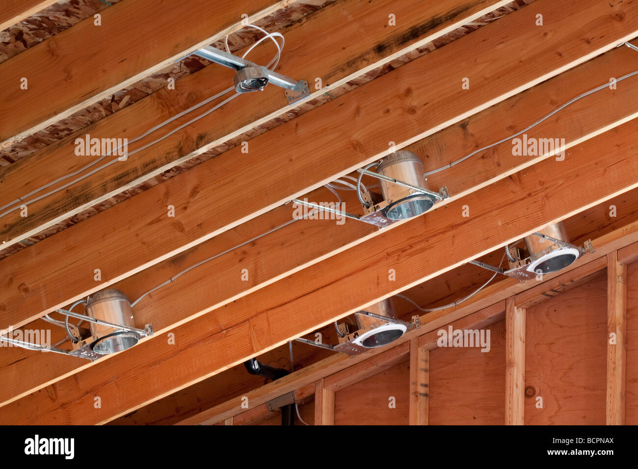 To Residential Construction Lighting Cans And Wiring Installed In The Rafters Of A Vaulted