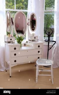 White dressing table with triple mirrors and white chair ...