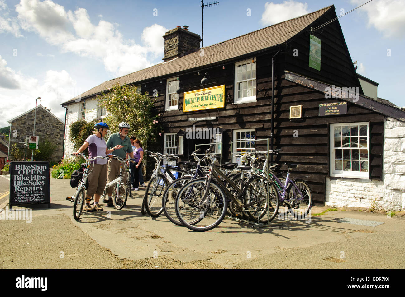 Mount Bike Shop Tourists On Their Bicycles Outside The Clive Powell Mountain Bike