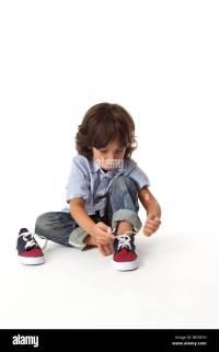 Little Boy Tying his Shoe Stock Photo, Royalty Free Image ...