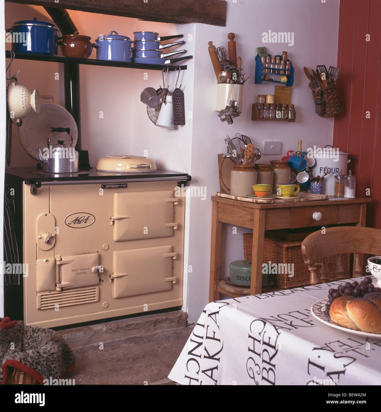 cream aga oven in white cottage kitchen with earthenware jars on small BEW42M