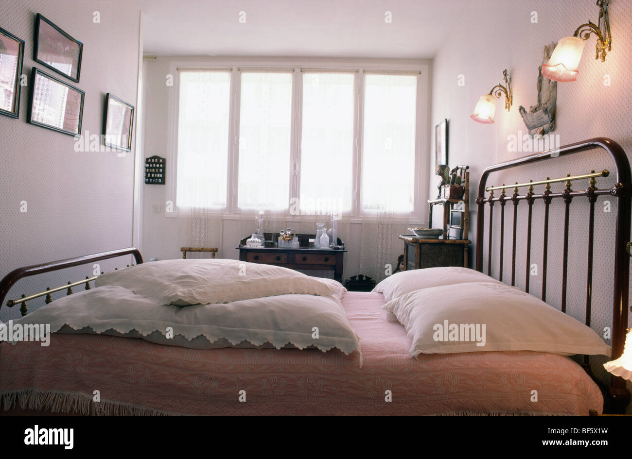 Over Bed Lights Victorian Glass Wall Lights Above Black Metal Bed With