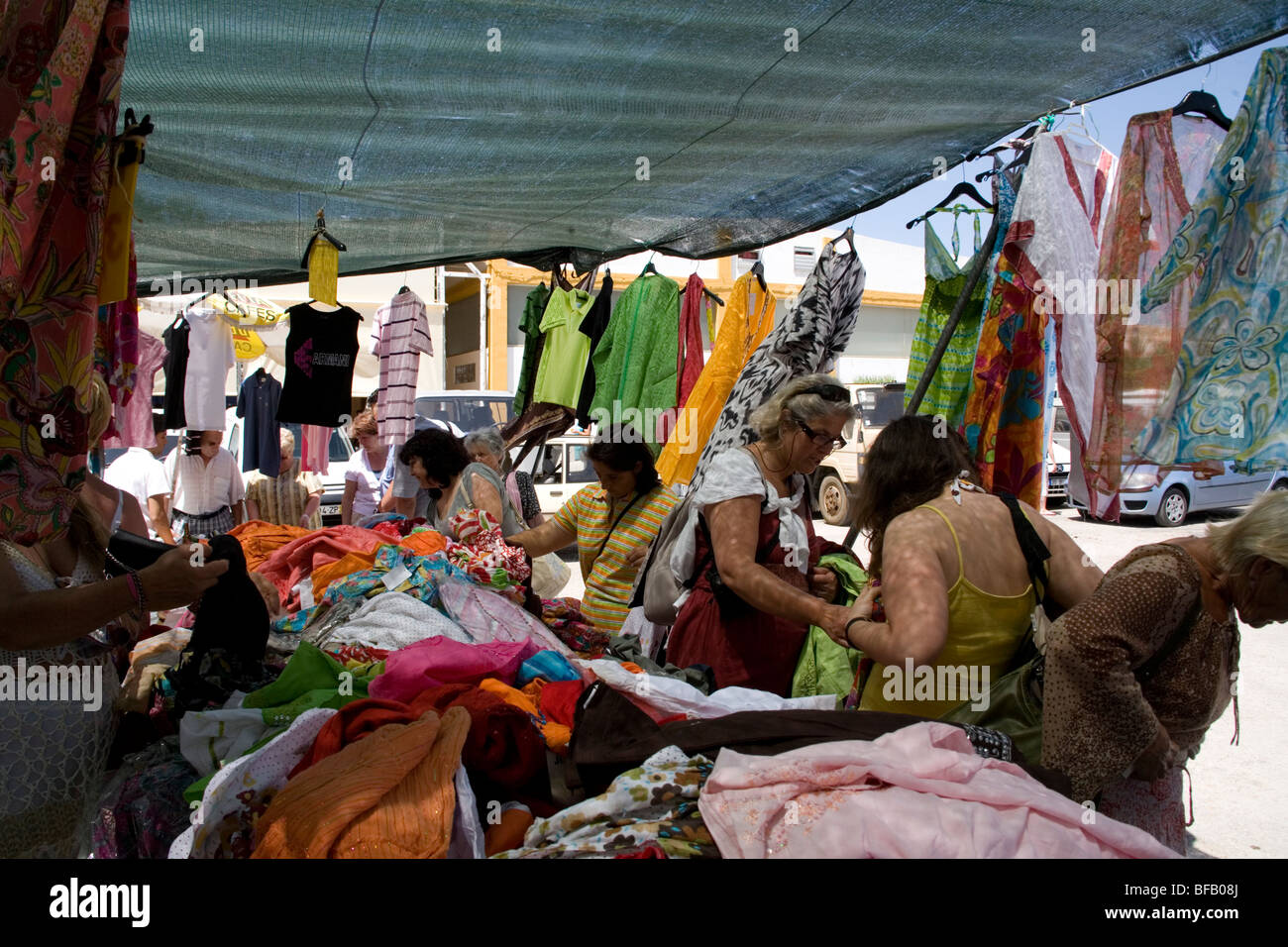 Sofa Cloth Online Shopping India Women Buying Indian Clothes On Open Air Market Stall In