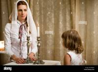 Mother and daughter lighting Shabbat candles Stock Photo ...