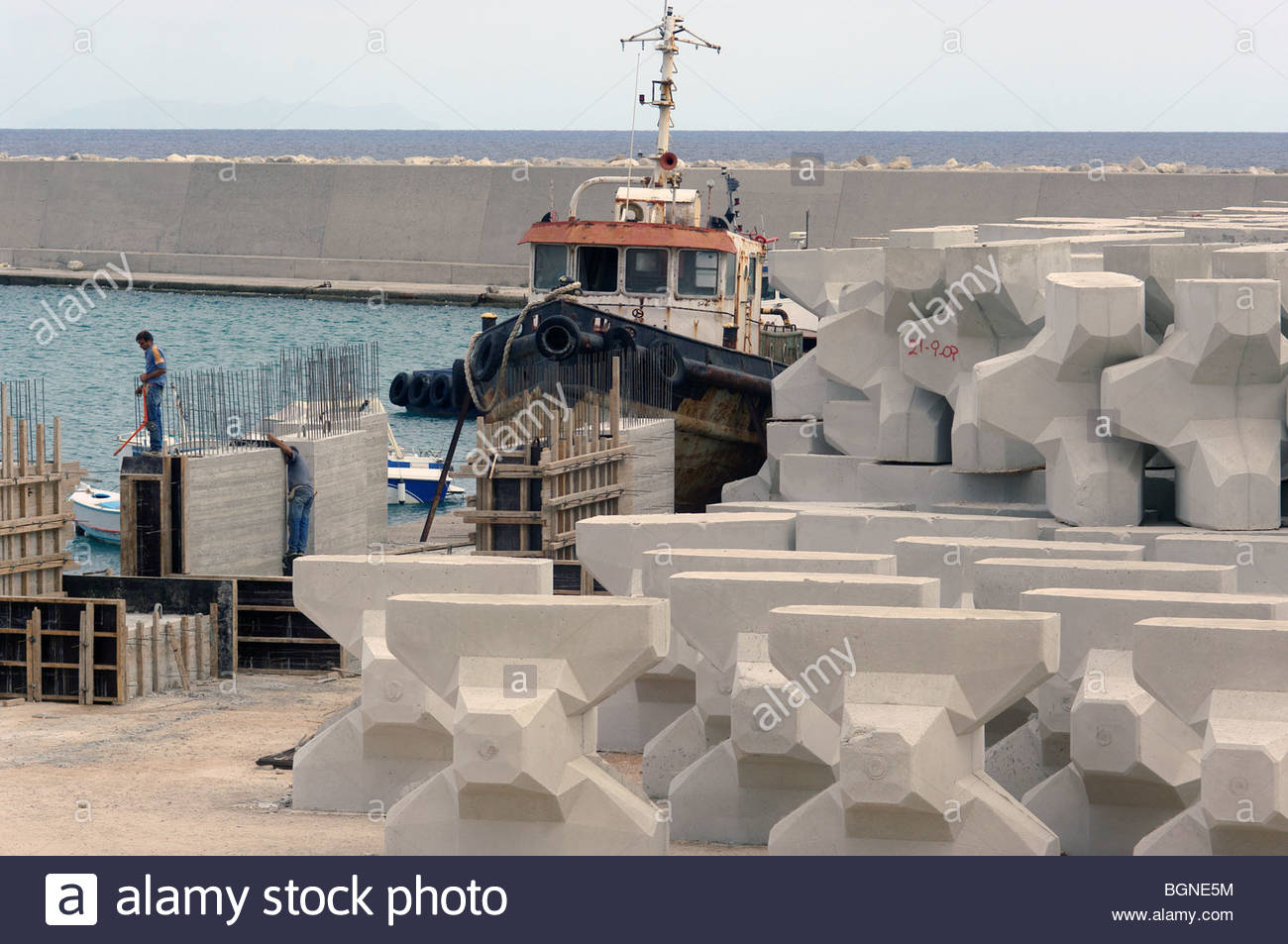 Cement Beton Building A Port In Greece Using Reinforced Concrete Caltrops